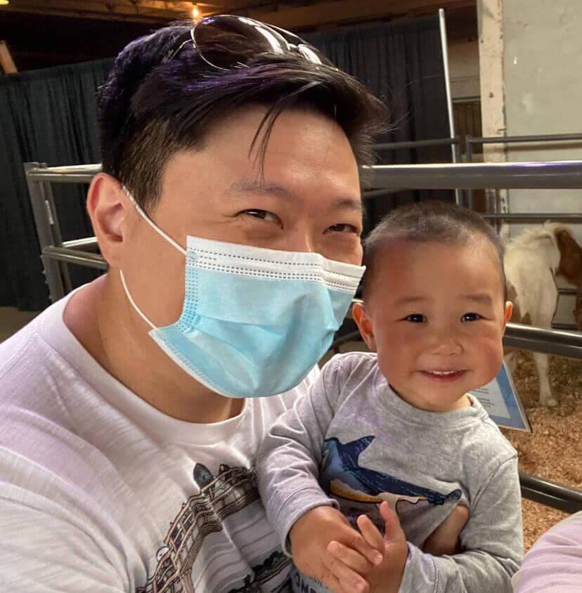 Gary Lai holding his child