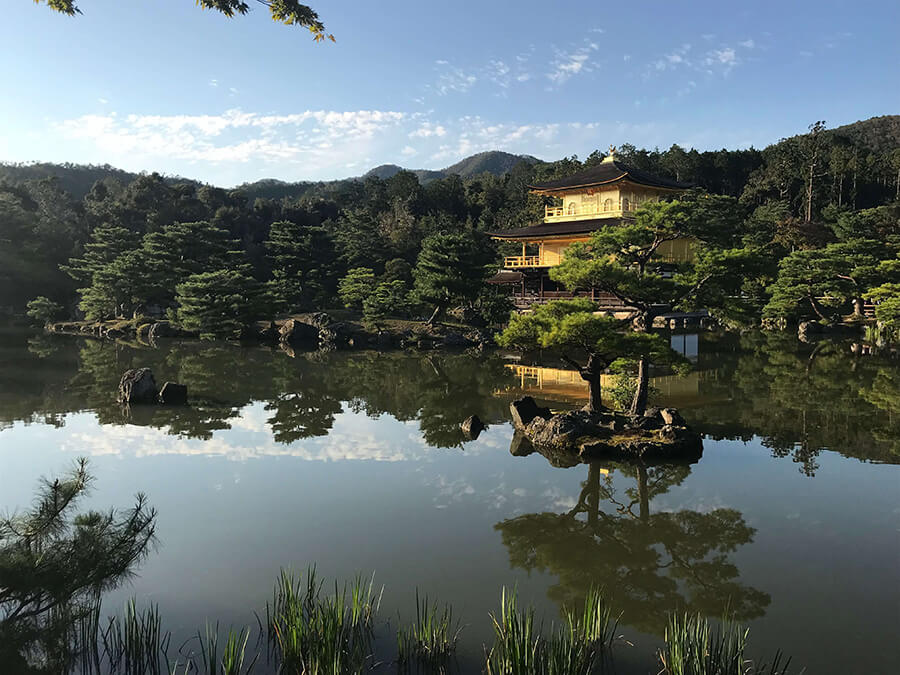Japanese building in forested area near water